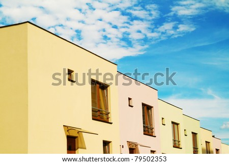beautiful colorful apartments with cloudy sky