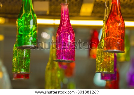 Beautiful colorful bottle hanging on the roof.