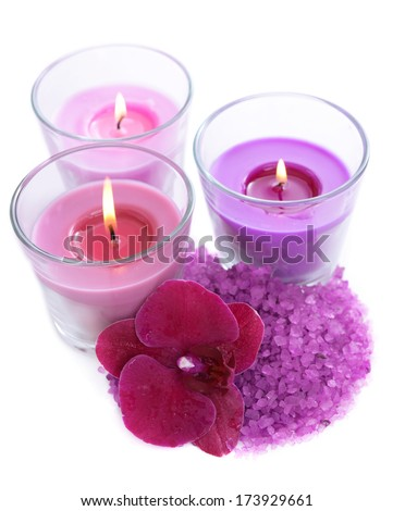 Beautiful colorful candles, orchid flower, sea salt isolated on white - stock photo