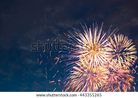 Beautiful colorful fireworks on sky. International Fireworks. Fireworks display on dark sky background. Independence Day, 4th of July, Fourth of July or New Year. - stock photo