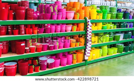 beautiful colorful flower pots on the shelves of a shop of garden household  - stock photo