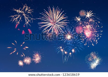 Beautiful colorful holiday fireworks in the night sky with star, long exposure - stock photo