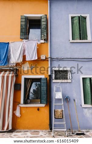 Beautiful Colorful House Facade On Burano Island North Italy Half Orange Half Light Blue