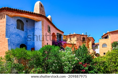 Beautiful colorful houses with nice garden, Porto Cervo, Sardinia, Italy - stock photo