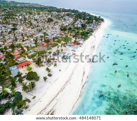 beautiful colorful landscape with ocean and African island Zanzibar, aerial photo from quadrocopter