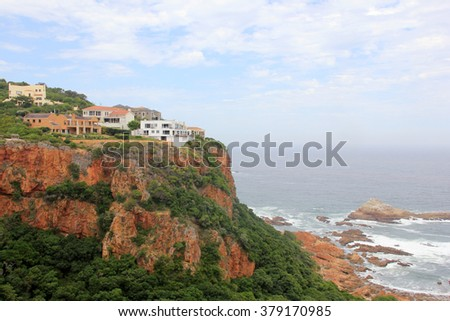Beautiful colorful rocky coastline of South Africa near town, ocean view over rocks, outdoors - stock photo