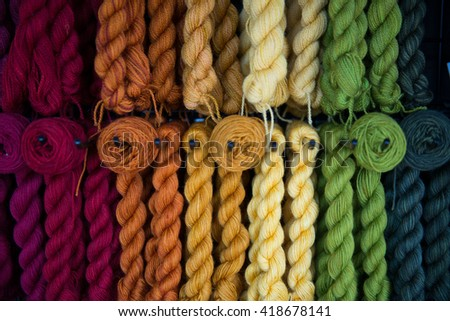 Beautiful colorful skeins of hand dyed natural yarn  - stock photo
