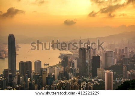 Beautiful colorful Sunrise over Victoria Harbor as viewed a top from Victoria Peak in Hong Kong - stock photo