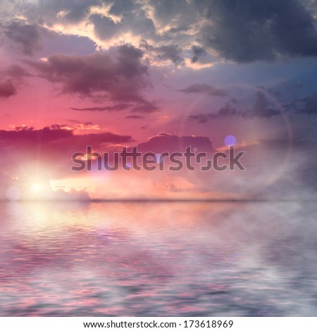 Beautiful colorful sunset over the middle of the ocean with beautiful fog