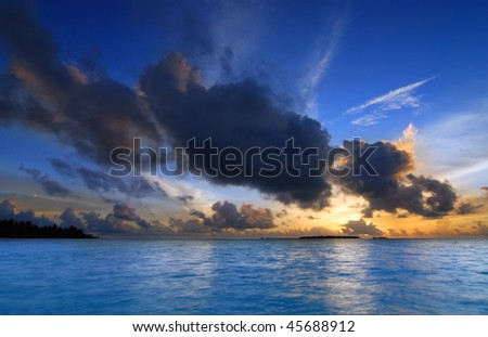 Beautiful colorful sunset over the ocean in the Maldives seen from the beach - HDR - stock photo