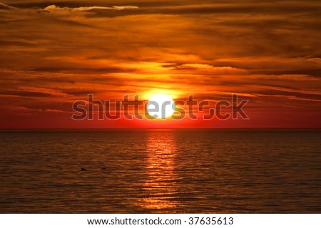Beautiful colorful sunset over the water in the Netherlands - stock photo