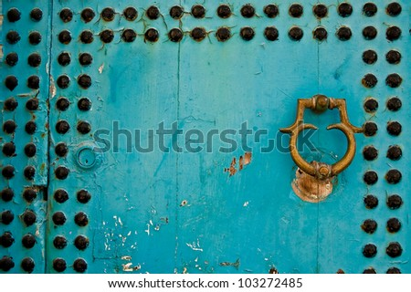 Beautiful colorful texture of old wooden doors with stylish wooden handle - stock photo