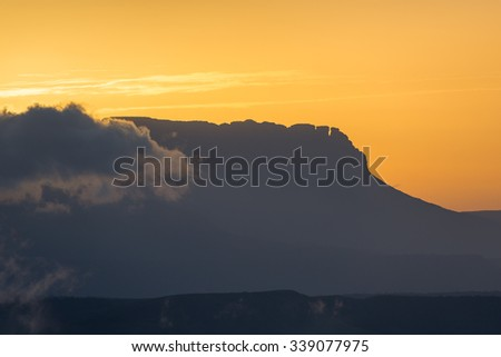 Beautiful colors at dawn with the silhouette of the eastern chain tepuys (table-top mountains), in Canaima National Park, Venezuela - stock photo