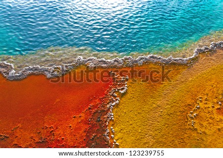Beautiful colors in a geyser pool, Yellowstone, Wyoming - stock photo