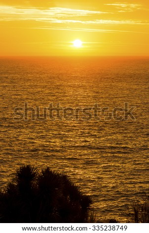 Beautiful colors of a sunrise over the ocean - stock photo