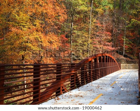 Beautiful colors of fall and rusting bridge