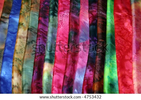 beautiful colors of hand died silk scarfs for sale in seattles world famous Pike Place Market aka Farmers Market - stock photo
