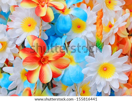 beautiful colors of plastic flowers. - stock photo