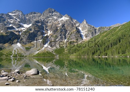 Beautiful colours of Morskie Oko mountain lake in spring time in High Tatras - stock photo