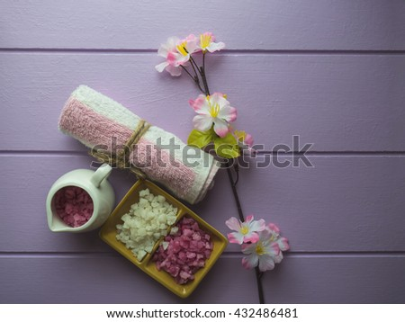 Beautiful composition of spa treatment on Purple background