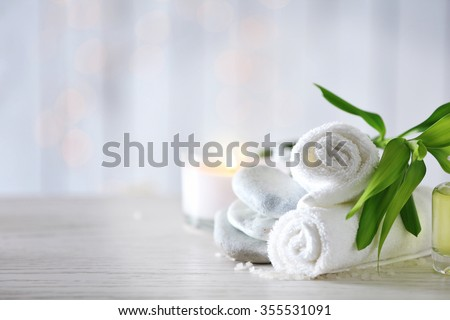 Beautiful composition of spa treatment on wooden table - stock photo