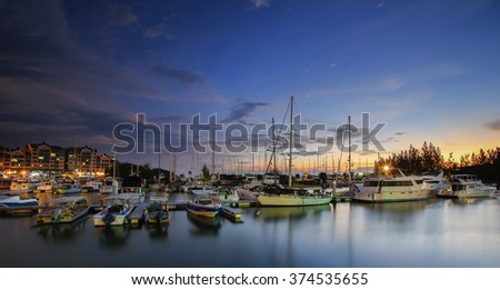 Beautiful composition view of Malaysian Harbour with a yatch during sunset.Vibrance colour , soft focus during long exposure , motion blur effect  - stock photo