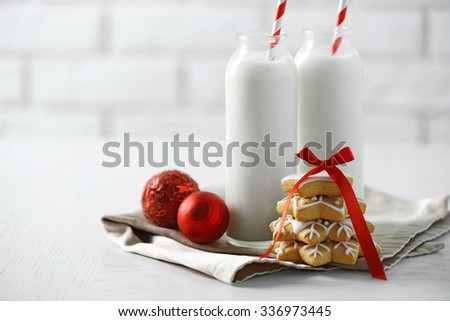 Beautiful composition with Christmas cookies and milk - stock photo