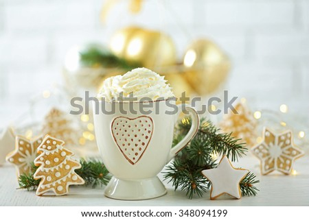 Beautiful composition with cup of cappuccino and Christmas cookies - stock photo