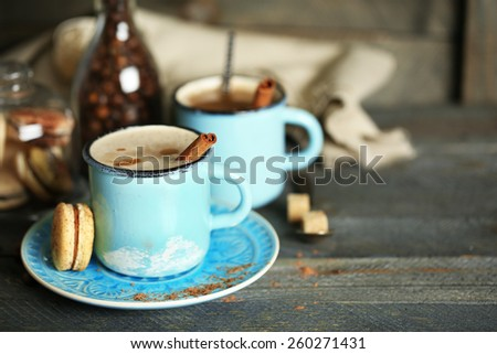 Beautiful composition with tasty cappuccino on wooden table - stock photo