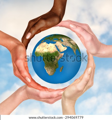 Beautiful conceptual symbol of the Earth globe with multiracial human hands around it. Unity and world peace concept. Elements of this image furnished by NASA - stock photo