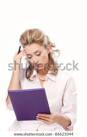 Beautiful concerned business woman reading important papers - stock photo