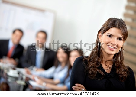 Beautiful confident business woman at the office