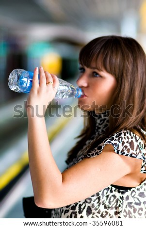 Beautiful confident businesswoman drink water after conference - stock photo