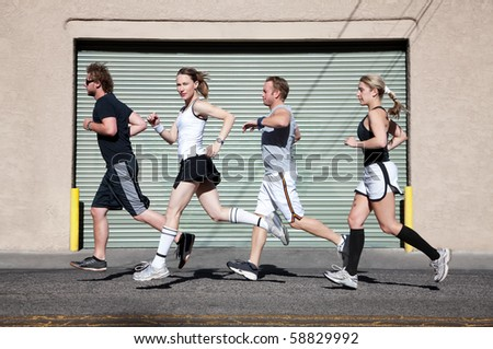 Beautiful, confident woman runs with friends. - stock photo