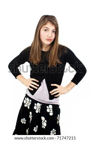 Beautiful confused teenage girl. Isolated on white background - stock photo