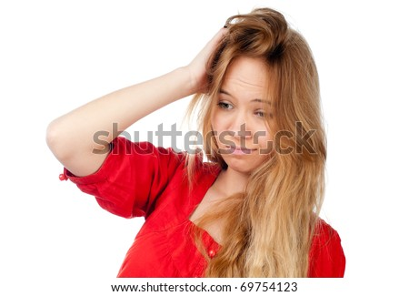 beautiful confused teenage girl with hand in her hair, looking away from camera, isolated on white background - stock photo