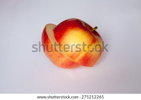 beautiful, consciously and tasty cut apple on a white background - stock photo
