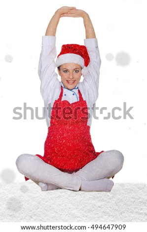 beautiful cook in Santa Claus hat with snow on white background