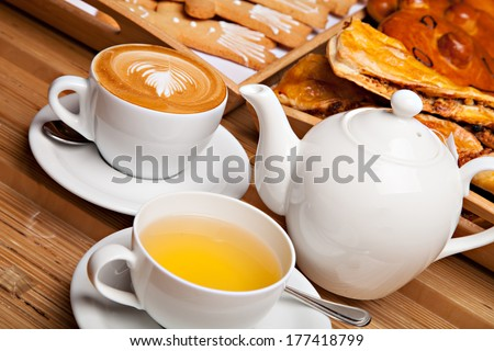 Beautiful cookie and bakery with cup of coffee and tea - stock photo