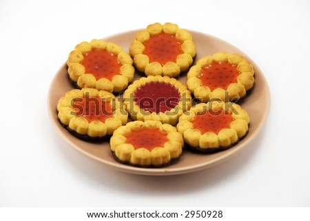 Beautiful cookies in a plate on a white background
