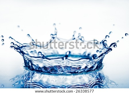 beautiful corona from splash of clean blue water - stock photo