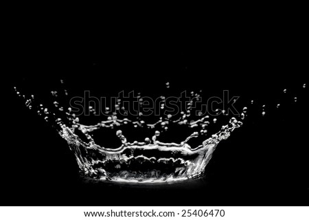 beautiful corona from transparent drop of water on black background - stock photo