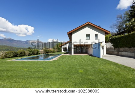 beautiful country house with swimming pool, outdoor - stock photo