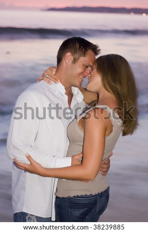 Beautiful couple at sunset on the beach.