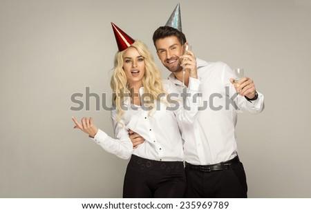 Beautiful couple celebrating new year's eve - stock photo
