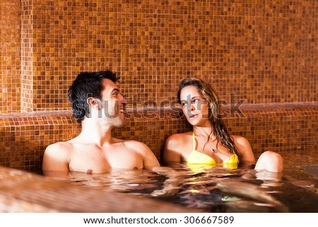 Beautiful couple doing a bath in a spa - stock photo