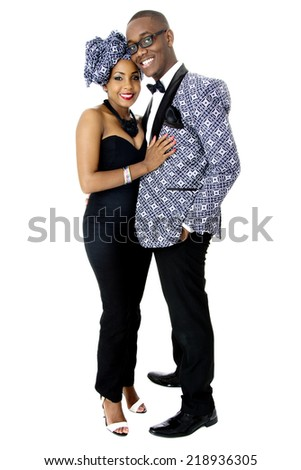 Beautiful Couple Dressed in Traditional African Clothes, in Studio, Over White - stock photo