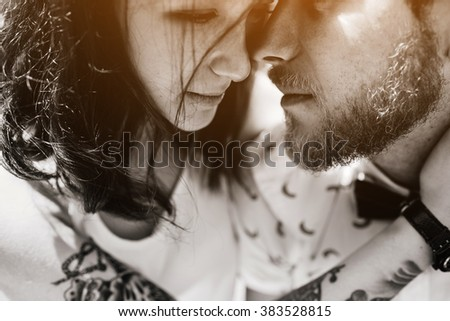 beautiful couple embraced and gently rubs noses - stock photo