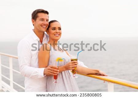 beautiful couple enjoying cruise vacation - stock photo