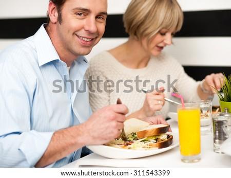 Beautiful couple having dinner at a restaurant - stock photo